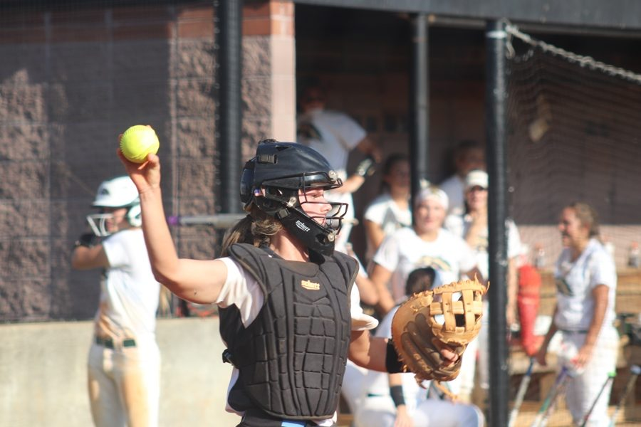 Junior Kate Ashmore throws the ball after catching it from a pitcher. She was one of the team leaders in runs batted in.