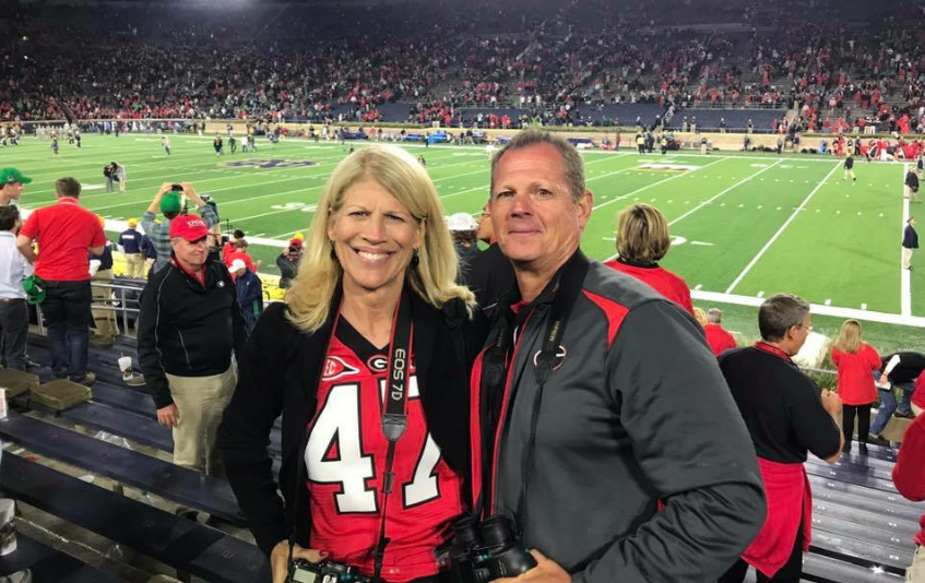 History+teacher+Jon+Gloer+and+his+wife+Kathy+pose+for+a+photo+before+the+University+of+Georgia+football+game+against+Notre+Dame+in+South+Bend%2C+Ind.++This+past+weekend%2C+the+Gloers+garnered+attention+on+social+media+after+a+Facebook+post+went+viral.