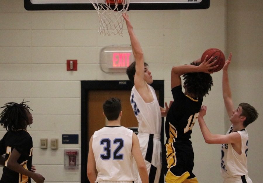 Sophomore forward Barrett Hester attempts to block a shot. Good defense allowed the Panthers to narrowly defeat Fayette County 47-45.