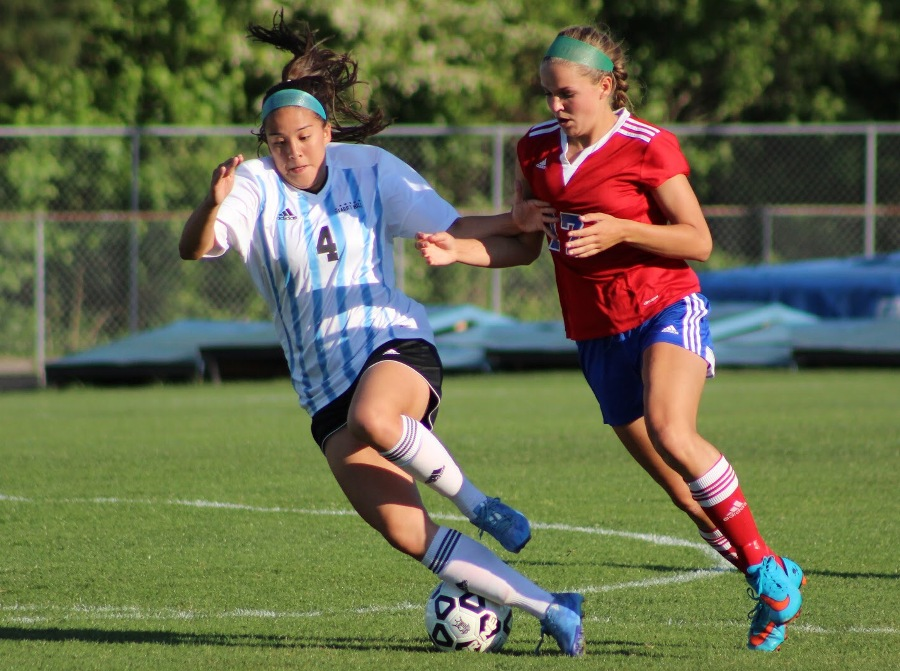 Alum Dylan Patterson drives the ball while a defender attacks aggressively. Patterson, in her sophomore year of college, has joined the Philippines national team to play in the 2019 FIFA Women's World Cup in France.