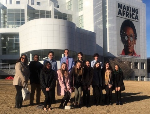 """AP Spanish students pose for a photo outside of the High Museum of Art in Atlanta. """"I've always really loved contemporary art, so that was probably my favorite part [of the museum],"""" senior AP Spanish student member Elena Wernecke said."""