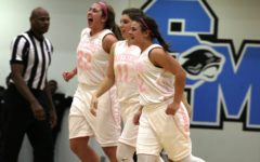 Three players celebrate after the big win. The Lady Panthers have now swept the Chiefs in the regular season and occupy the top spot in region 3-AAAAA.