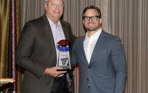 SMI President Marcus Smith (right) awards Ed Clark Promoter of the Year for Speedway Motorsports Inc. due to his hard work and drive to maintain Atlanta Motor Speedway as the best track every year. SMI owns and operates eight NASCAR-sanctioned race tracks around the country.