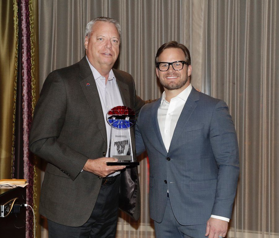 SMI+President+Marcus+Smith+%28right%29+awards+Ed+Clark+Promoter+of+the+Year+for+Speedway+Motorsports+Inc.+due+to+his+hard+work+and+drive+to+maintain+Atlanta+Motor+Speedway+as+the+best+track+every+year.+SMI+owns+and+operates+eight+NASCAR-sanctioned+race+tracks+around+the+country.
