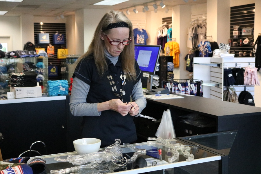 """Jan Davis works in the Atlanta Motor Speedway gift shop where she sells merchandise to NASCAR-crazed fans like her. Davis has been a NASCAR fan for 51 years and enjoys when fans come into the gift shop to tell her about """"their"""" driver."""