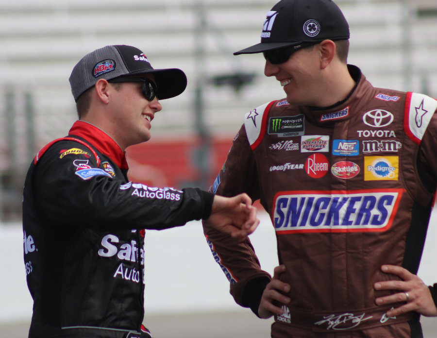 Kyle Busch (right) talks to his teammate Noah Gragson (left) for Kyle Busch Motorsports. Gragson qualified in the top five, with the third fastest lap time of 30.935 seconds, while Busch captured the pole with a time of 30.844 seconds.