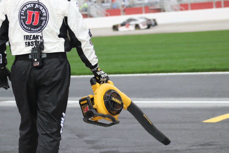 Pit crew member for Kevin Harvick blows off the team's pit stall after rain delayed the start of the race 2.5 hours. In the No. 4 Jimmy Johns Ford, Harvick dominated the 59th Annual Folds of Honor QuikTrip 500 leading a race-high 181 laps.