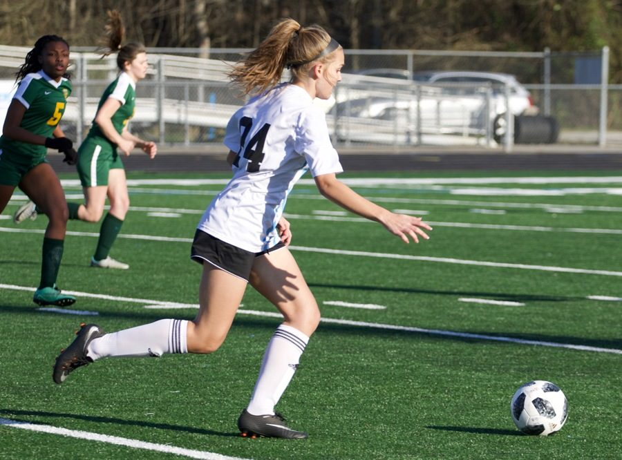 Senior Kirsten Oates dribbles the ball down the field outside of the goalie box. The Mill dominated the Griffin Bears in a shutout region match 10-0.