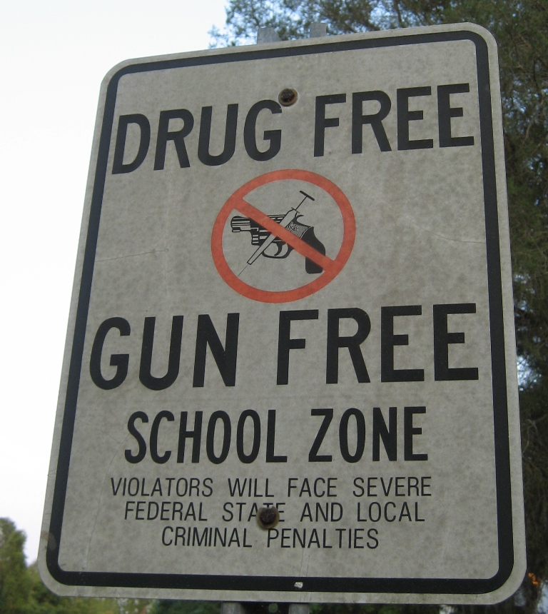 A+sign+prohibiting+drugs+and+guns+stands+outside+of+a+school.+If+teachers+were+to+be+armed%2C+schools+shootings+may+be+a+thing+of+the+past.+