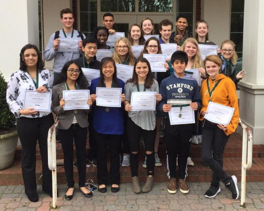 Students pose with their awards from the Foreign Language Association of Georgia Spoken Language Contest. The group of 21 students returned to the Mill with 14 superior rankings, five excellent, and two distinguished.