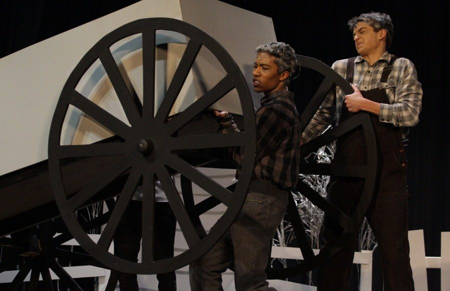 Hickory+and+Hunk%2C+depicted+by+seniors+Douglass+Morris+and+Lou+Conti%2C+enter+carrying+a+wagon+prop.+Many+props+and+movable+set+pieces+were+used+throughout+the+show.+