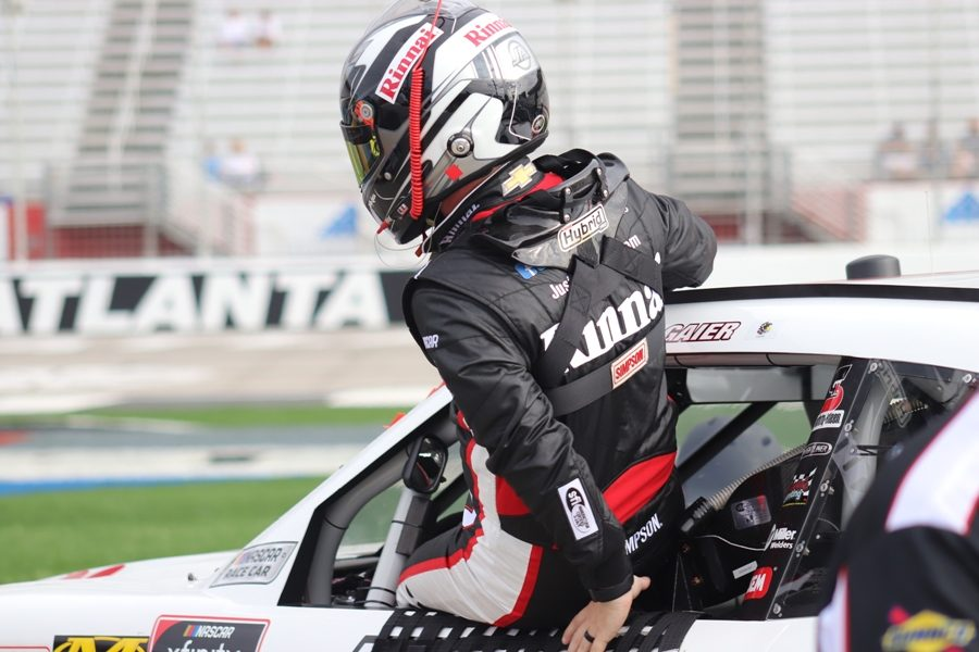 Justin Allgaier, driver of the No. 7 for JR Motorsports in the Xfinity Series, climbs into his race car for Saturday morning practice sessions at Atlanta Motor Speedway. Drivers are always thinking about what they can do during and after the race to stay safe and try to win.