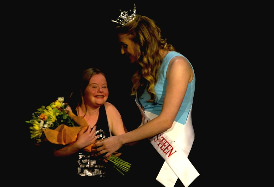 Spectators of the PALS pageant voted for the People's Choice award, and Sarah Dorr presented the winner with a bouquet of flowers as the crowd cheered for her. With the silent auction and people's choice, PALS raised over $1,800.