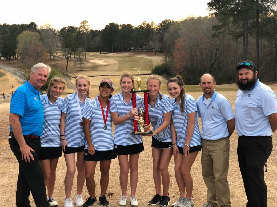 The+team+poses+for+a+picture+with+their+first+place+trophy.+The+team+won+by+10+strokes+ahead+of+second+place+Ola+High+School.