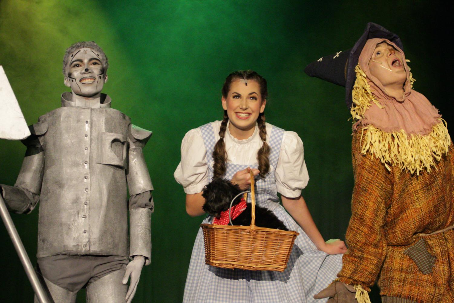 Seniors Douglass Morris, Jo Dearman, and Lou Conti perform as Tinman, Dorothy, and Scarecrow, respectively.