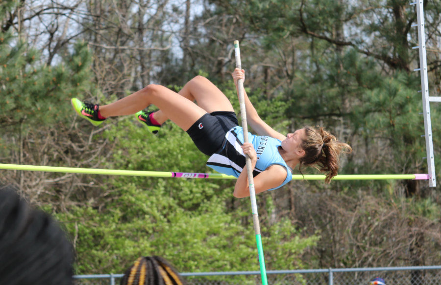 Senior+Kalani+Serapian+clears+the+bar+during+the+pole+vaulting+event.+Serapion+placed+11th+out+of+19+vaulters+with+a+height+of+8.06+feet.+Ashton+Smallwood+from+Alexander+High+School+placed+first+with+a+final+vault+of+9.06+feet.+