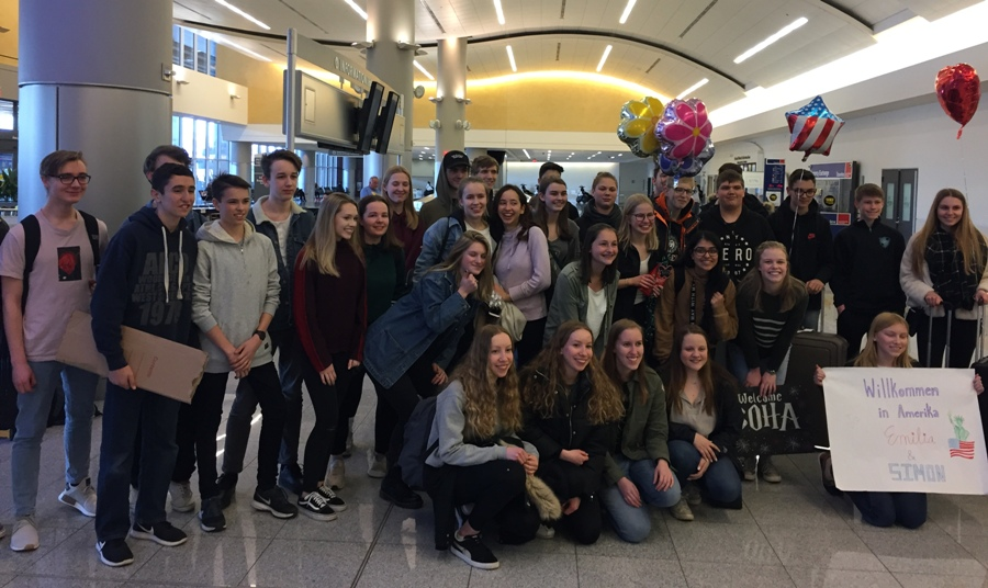 American partners welcome German exchange students at the airport. They stayed for three weeks, arriving on March 19 and returning home on April 11.