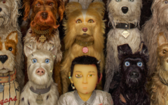 """The young boy at the center of """"Isle of Dogs,"""" Atari Kobayashi, surrounded by the furry friends he makes along the way. While visually engaging, """"Isle of Dogs"""" not only presented a lackluster story but has found itself at the center of a heated debate regarding media and culture."""