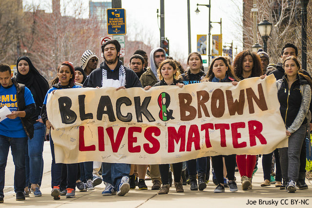Students at a protest fighting for black and brown lives. Partaking in ideals such as arming teachers will only increase the oppression they face.