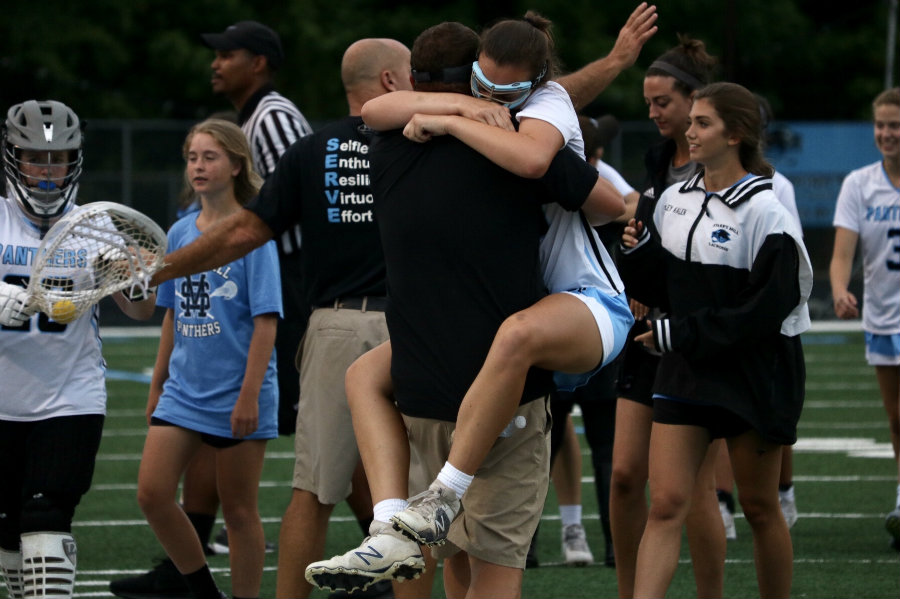 Panther player and coach celebrate their Final Four victory over Westminster. By defeating the Lady Wildcats, Starr's Mill advanced to their first ever state championship game. They will take on Blessed Trinity, the winner of the past two state championships.