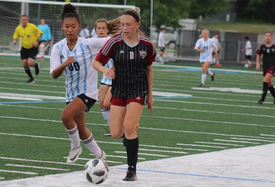 Lady Panther chases a Wildcat player down the field. The Mill spent the majority of the Final Four game chasing after Whitewater. The Wildcat offense, led by junior Madison Wright's hat trick, continued to overpower the Panther defense throughout the game.