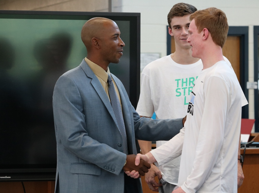 New boys' basketball coach Charlemagne Gibbons meets juniors Nick Weist and Nate Allison during a conference with school staff, students, players, and parents. Gibbons joins the Starr's Mill family after his previous tenure as an assistant coach at Florida Atlantic University.