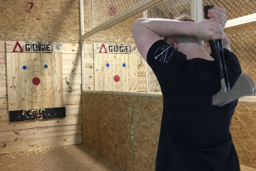 Zack Fair, owner of Agoge, prepares to throw two axes at once. Agoge is a new business that opened on May 5 in the Braelinn Village in Peachtree City. The business specializes in throwing various weapons for fun, competition, and as an alternative form of exercise.