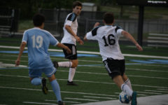 Starr's Mill player prepares to pass the ball to another Panther, preventing a Knight from intersecting the ball. The Panthers lost the final four game against the Johnson Knights 4-1, ending their season.