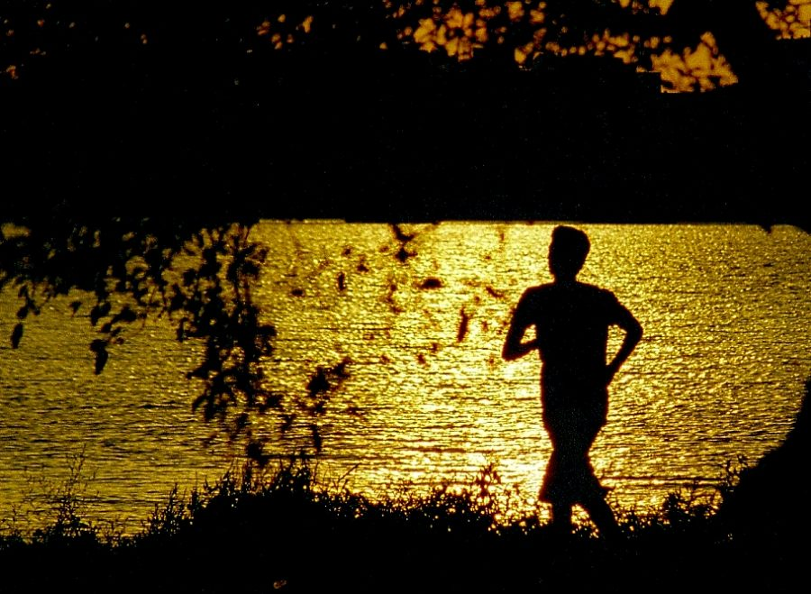 Man+goes+on+an+evening+jog.+While+most+individuals+run+to+gain+physical+strength%2C+running+on+a+regular+basis+can+also+improve+our+mental+health+and+teach+us+the+value+of+hard+work.