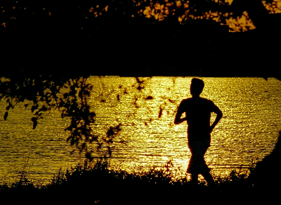 Man goes on an evening jog. While most individuals run to gain physical strength, running on a regular basis can also improve our mental health and teach us the value of hard work.