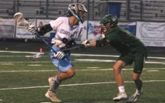 Titan defender checks a Panther Player. The Titans physical defense wore down the high powered Starr's Mill offense. Despite averaging 17 goals per game, Blessed Trinity held the Panthers to a season-low six goals.