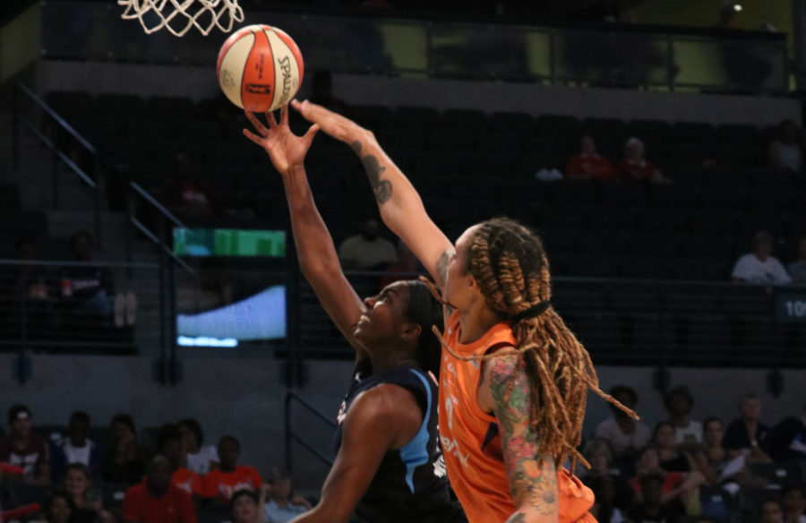 Mercury center Brittney Griner defends Dream forward Elizabeth Williams as she attempts a layup. The Dream averages 76 points per game, but came up short only scoring 71 in Sunday's loss to the Phoenix Mercury.