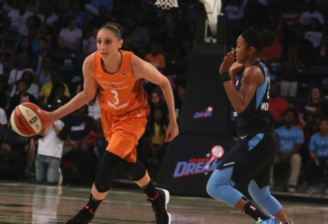 Atlanta guard Renee Montgomery avoids fouling Phoenix guard Diana Taurasi. Taurasi led the Mercury with 20 points, 8 assists in the team's 78-71 win over the Dream.