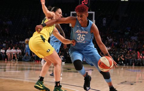 Forward Angel McCoughtry drives past Seattle Storm guard Sue Bird. McCoughtry was the second highest scorer of the night with 26 points for the Dream. Forward Breanna Stewart led all scorers with 29 points as the Storm defeated the Dream 95-86.
