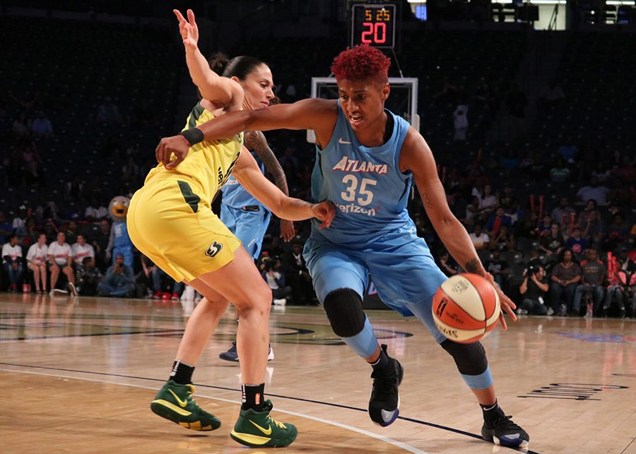 Forward+Angel+McCoughtry+drives+past+Seattle+Storm+guard+Sue+Bird.+McCoughtry+was+the+second+highest+scorer+of+the+night+with+26+points+for+the+Dream.+Forward+Breanna+Stewart+led+all+scorers+with+29+points+as+the+Storm+defeated+the+Dream+95-86.++