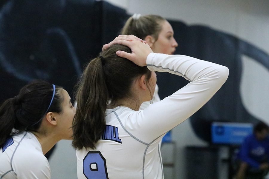 Senior Kaylee Leachman watches her teammates during their match against Newnan. The Panthers lost to the Cougars in three intense and close games.