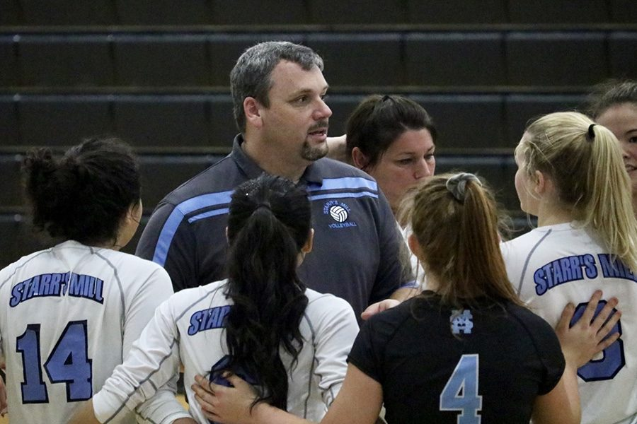 Coach+Flowers+talks+to+the+volleyball+team+during+a+timeout.+The+Lady+Panthers+are+off+to+a+strong+start+with+a+6-4+record.