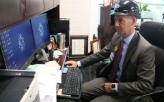 Starr's Mill Principal Allen Leonard prepares himself for the 2018-19 school year. While on his computer he shows some of the school's new technology elements.