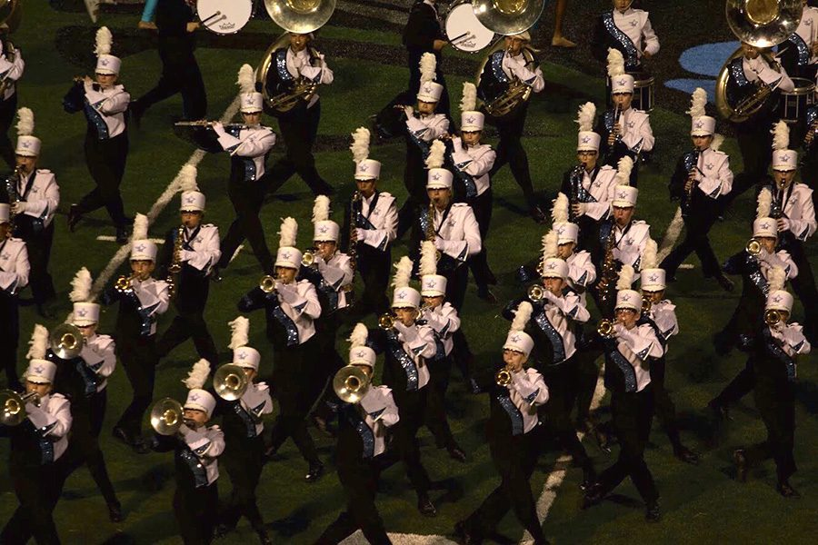 The+Panther+Pride+marching+band+performs+%E2%80%9CThe+Wedge%E2%80%9D+as+part+of+this+year%E2%80%99s+routine.+This+Friday%2C+the+band+will+recognize+all+of+the+students%2C+past+and+present%2C+who+have+qualified+to+march+in+the+Macy%E2%80%99s+Thanksgiving+Day+Parade.