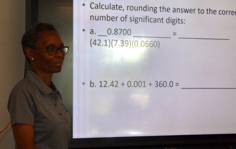 Toyin Mafe teaches her chemistry class about significant figures. Mafe joins the Starr's Mill staff after previously teaching at Riverdale High School.