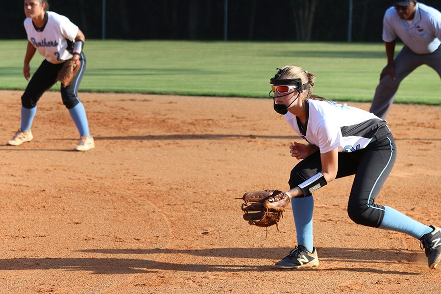 Junior+Paige+Andrews+in+ready+position+at+first+base.+Senior+Wakana+Sato+struck+out+six+of+the+nine+batters+she+faced%2C+leaving+the+Lady+Panther+defense+with+little+to+do.