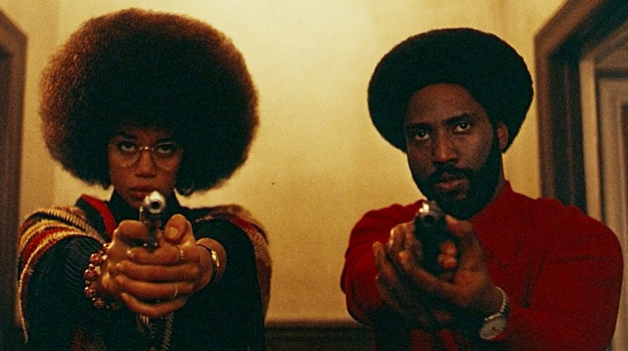 Ron+Stallworth+%28John+David+Washington%29+and+Patrice+Dumas+%28Laura+Harrier%29+stand+with+weapons+drawn+during+the+film%E2%80%99s+finale.+%E2%80%9CBlacKkKlansman%E2%80%9D+is+cinematically+near-perfect+and+politically+complicated.