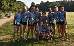 Varsity girls' cross county team poses for a picture after the Providence Invitational. The varsity boys and girls finished third overall, and the JV boys finished fifth overall.