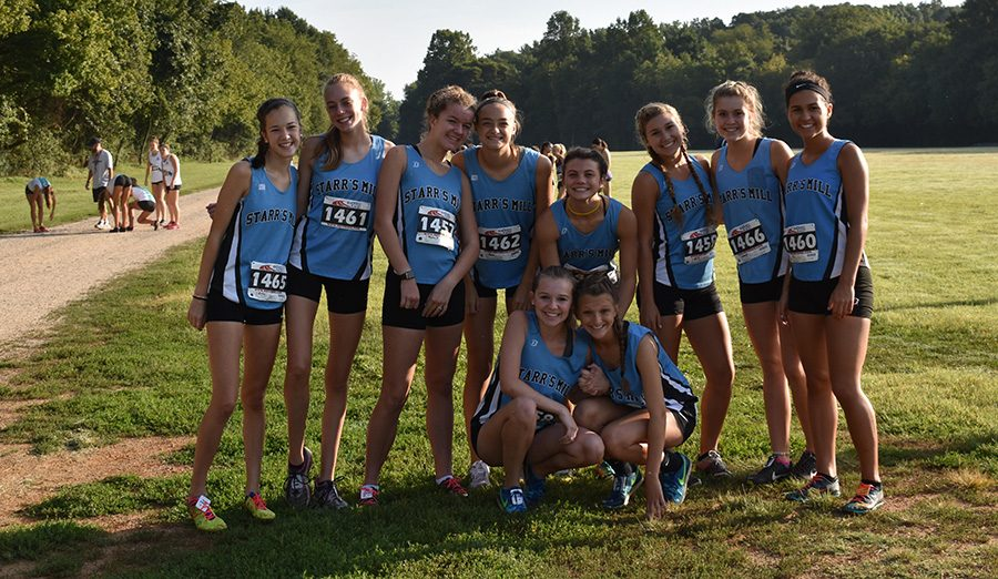 Varsity+girls%E2%80%99+cross+county+team+poses+for+a+picture+after+the+Providence+Invitational.+The+varsity+boys+and+girls+finished+third+overall%2C+and+the+JV+boys+finished+fifth+overall.+