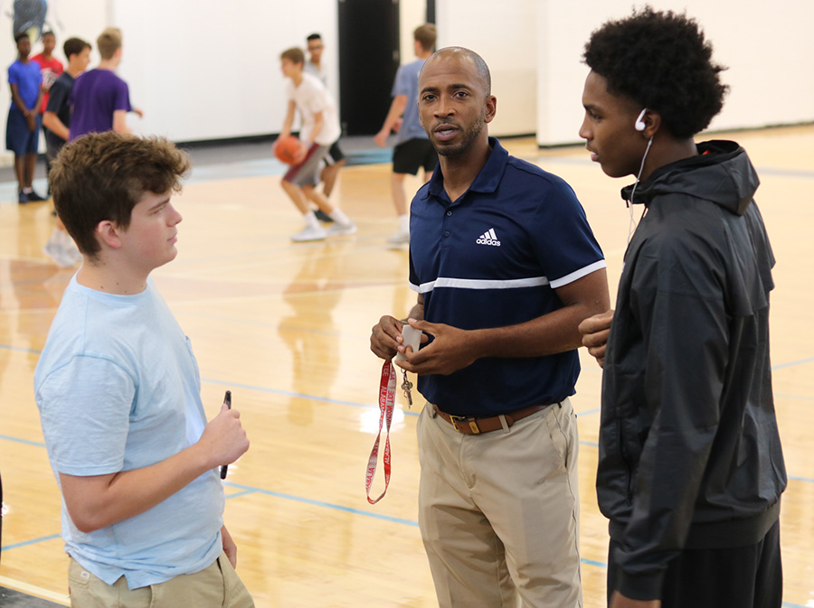 """Editor-in-Chief Rilee Stapleton (left) interviews head basketball coach Charlemagne Gibbons (middle) and transfer Jamaine Mann (right). Mann, a 6'5"""" junior, previously played for Eagles Landing Christian Academy. The forward averaged 10.6 points and 7.8 rebounds as a sophomore last year."""