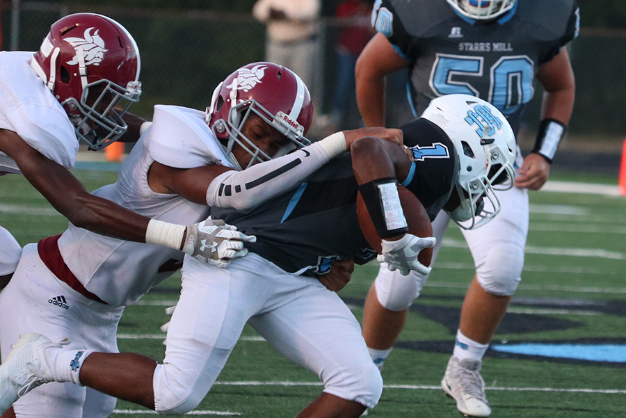 Northgate defender drags down junior running back Kalen Sims. Sims rushed for 148 yards and three touchdowns against the Vikings, but it wasn't enough as the Panthers fell 31-29.