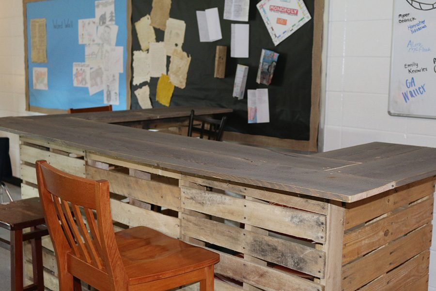 One+of+the+high+tables+history+teacher+Jason+Flowers+made+for+his+new+flexible+classroom.+The+tables+were+made+from+extra+pallets+left+after+the+summer+renovation.+The+seating+allows+the+students+to+learn+in+an+informal+setting.