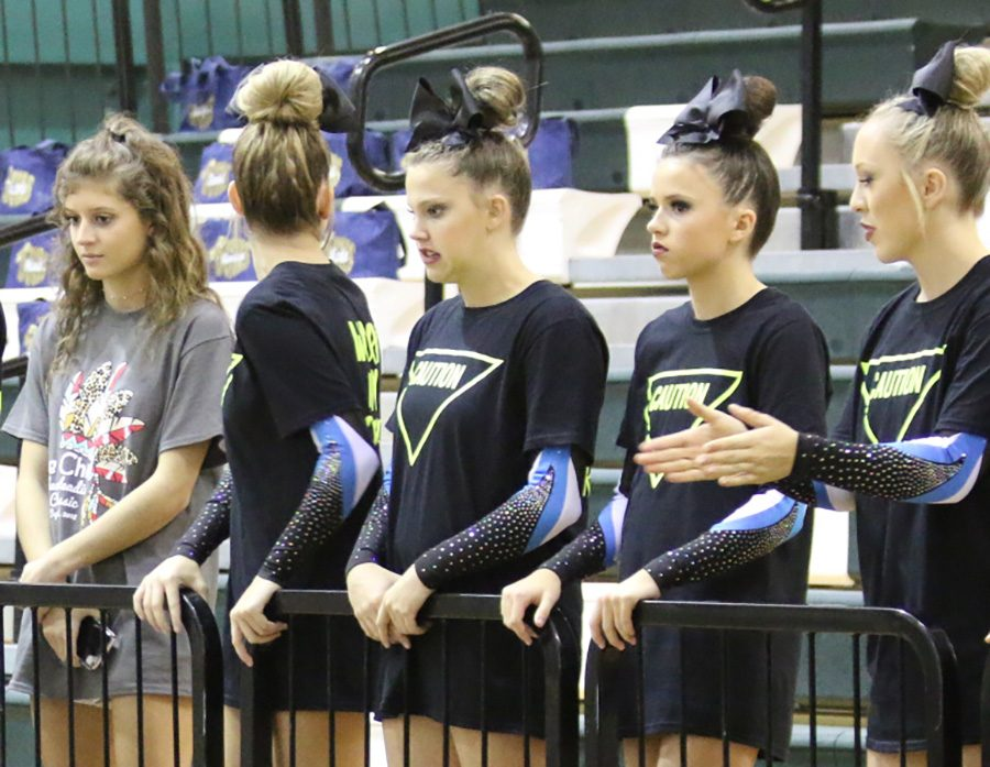 Starr's Mill varsity cheerleaders await their turn to perform. Both the varsity and JV Lady Panthers finished second overall at McIntosh on Saturday. Varsity placed behind last year's state champs Carrollton.