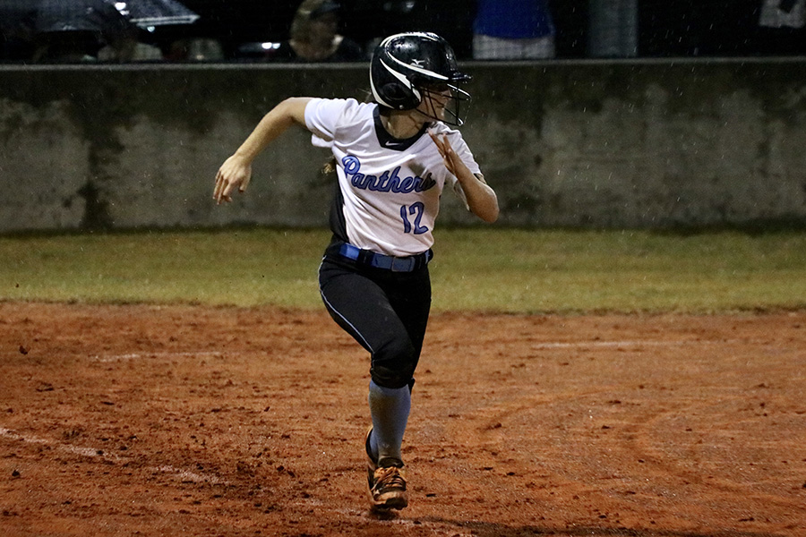 Sophomore Lauren Flanders runs to first base. The Lady Panthers consistently got on base during both games. Starr's Mill was also able to steal bases, allowing them to have runners in scoring position.