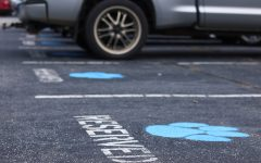 Leonard shows principles, moves parking spot